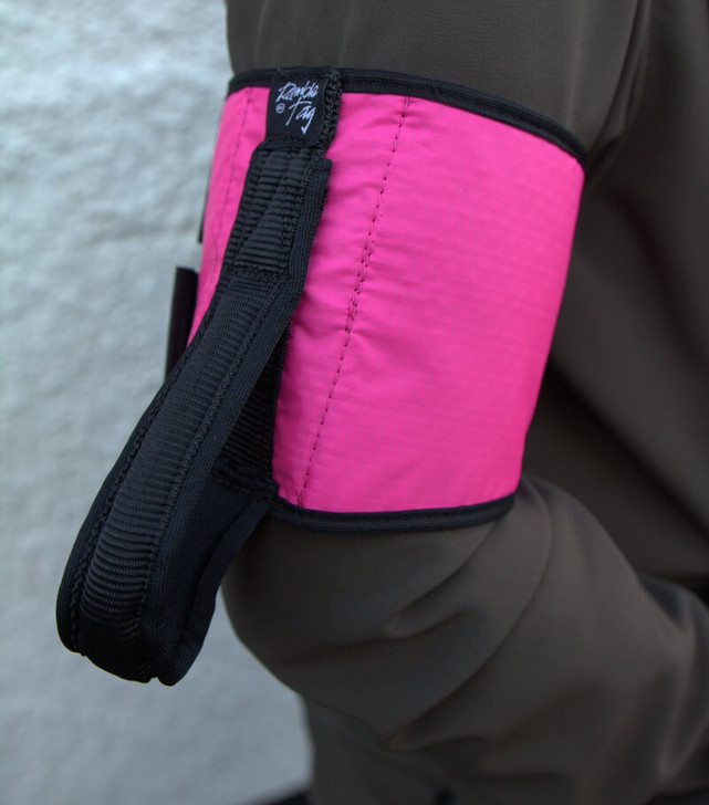 Pink Ramble Tag Original on a guides right arm providing additional mobility guidance for individuals with sight loss.