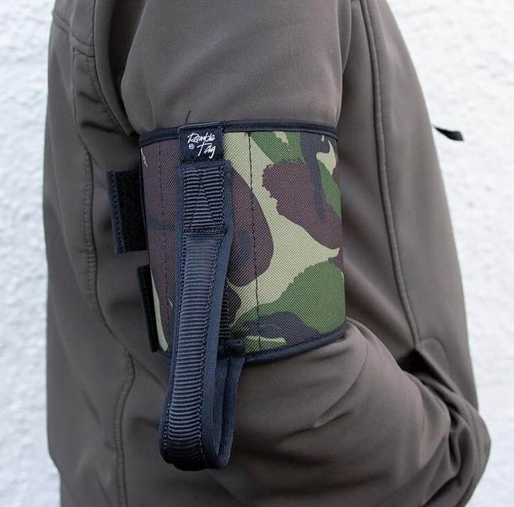 Camouflage Ramble Tag Original on a guides right arm providing additional mobility guidance for individuals with sight loss.