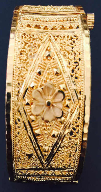 One Gram Gold Plated Bangle with flower art works    buy online now. Free Shipping Australia wide   Free size to fit up to a 2.6 sized bangle.
