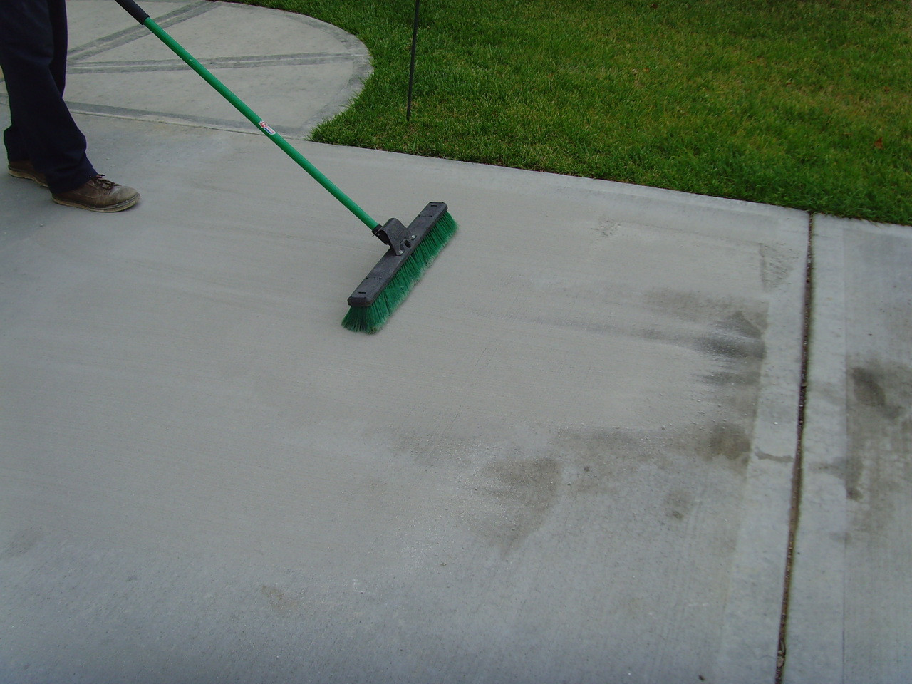 SealGreen Waterless Oil Cleaner is applied dry to the oil stain.