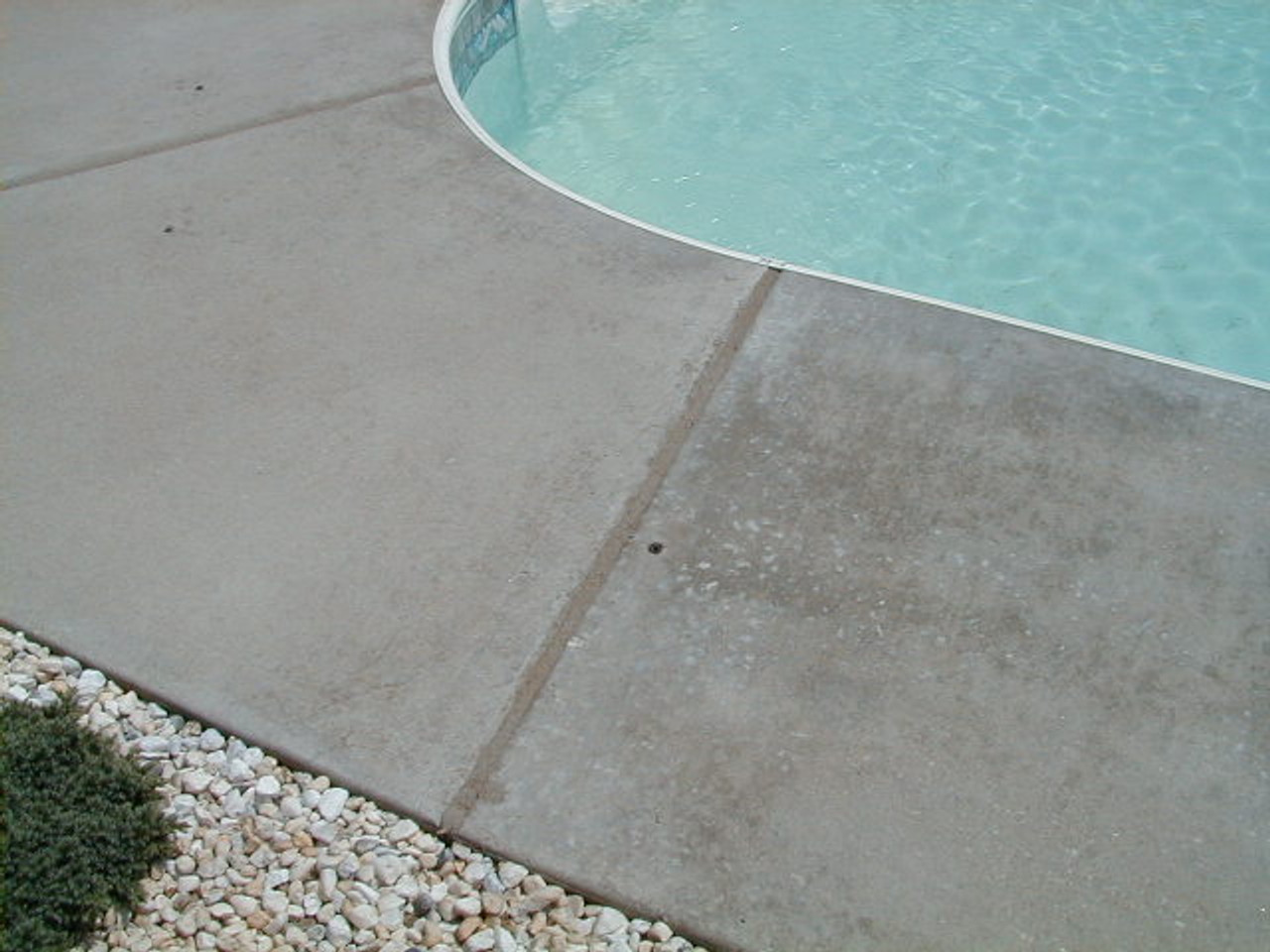 Clean and seal expansion joint on a concrete pool deck
