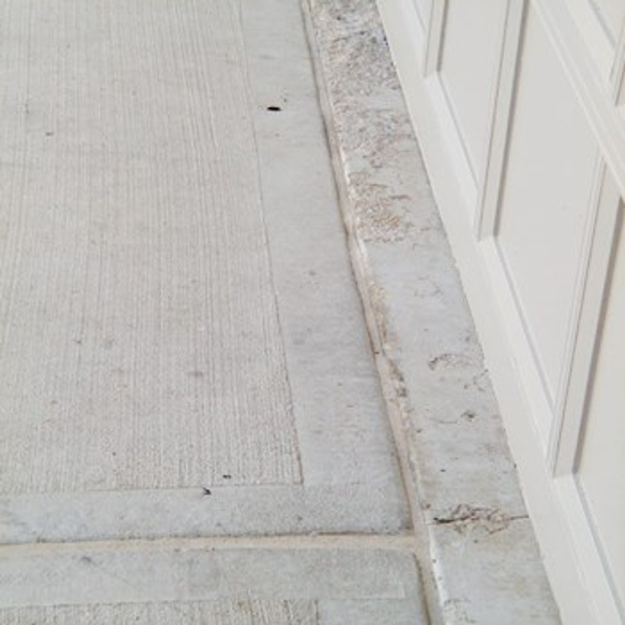 Clean and seal expansion joint with flexible caulk to allow movement