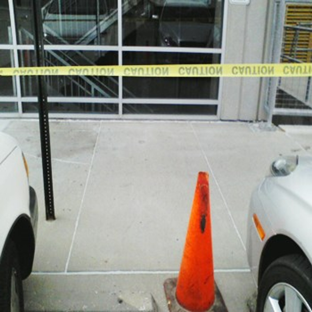 Clean and seal expansion joints on a commercial sidewalk