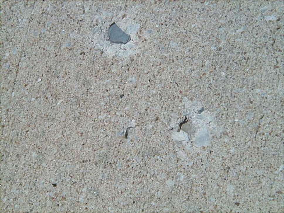 Holes in concrete driveway - Lignite or Shale Problem