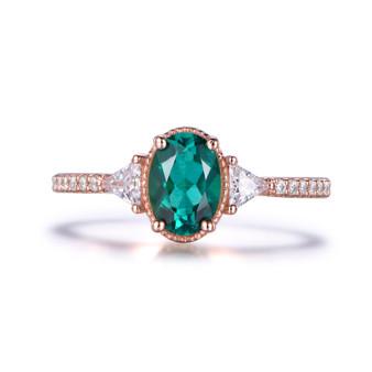 Three-Stone Oval Emerald Engagement Ring Trillion Moissanite Side Stones Milgrain 14k Rose Gold