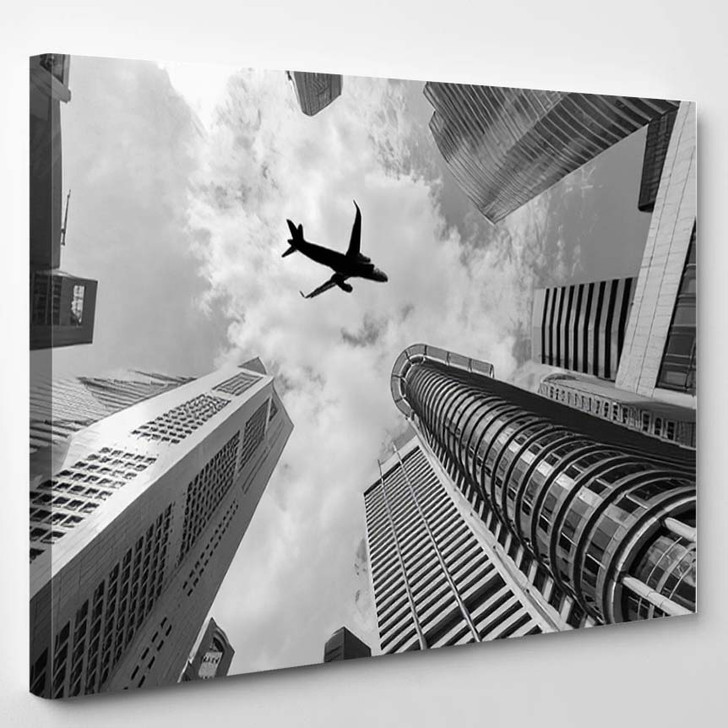 Air Plane Flying Over High Buildings - Airplane Airport Canvas Art Print