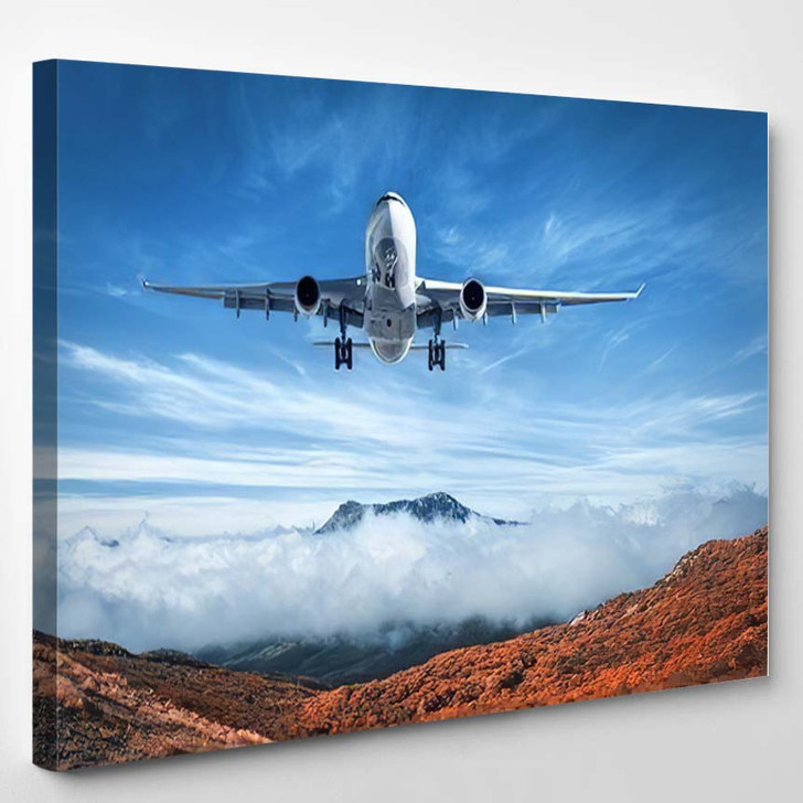 Airplane Flying Over Low Clouds Mountains - Airplane Airport Canvas Art Print