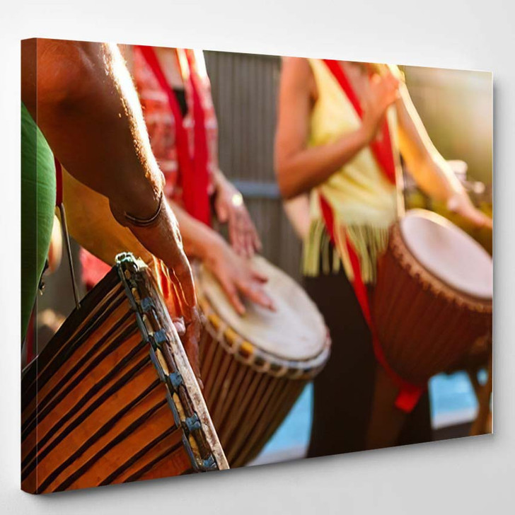 Close Peoples Hands Playing On African - Drum Music Canvas Art Print