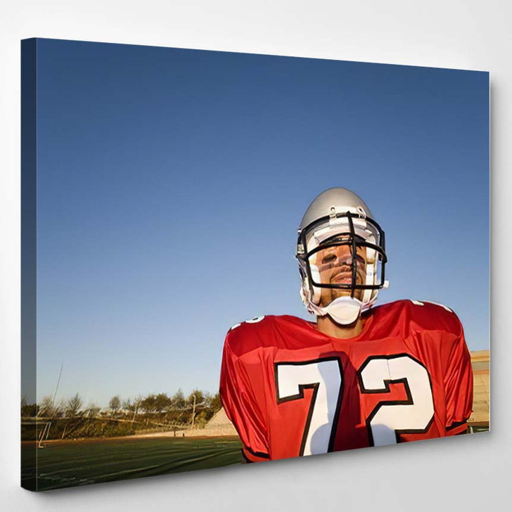 American Football Player Standing On Pitch - Football Canvas Art Print
