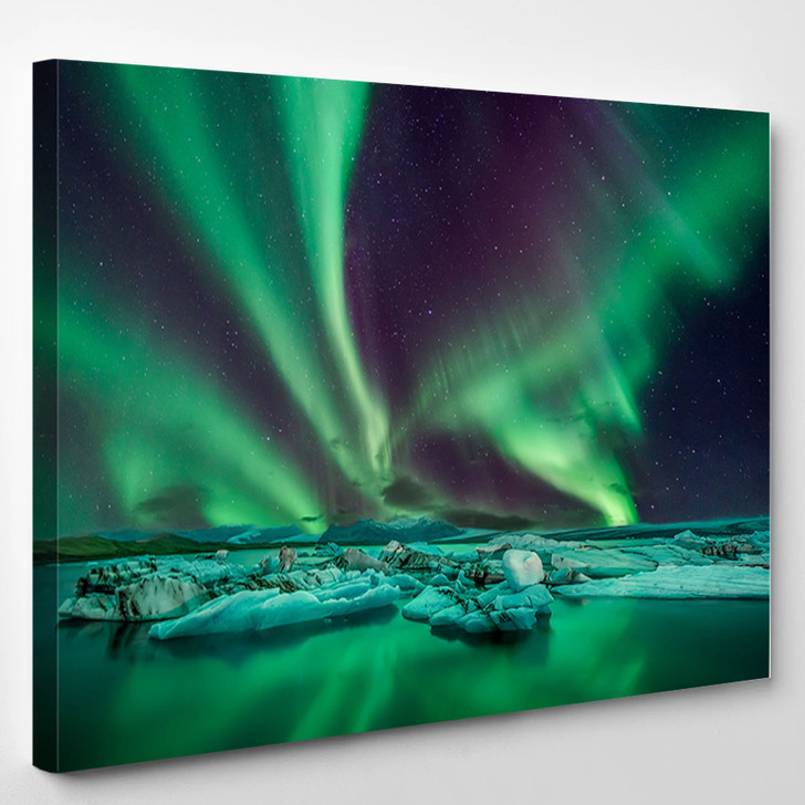 Northern Lights Flying Over The Glacier Lagoon In Iceland - Nature Canvas Art Print