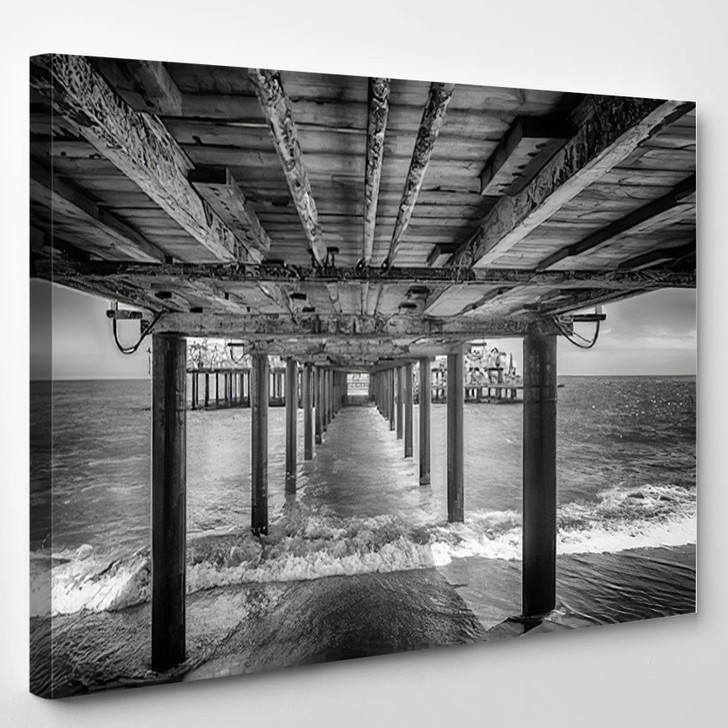 The Underside Of A Pier With Rest Area On The End Of It Black And White - Landscape Canvas Art Print