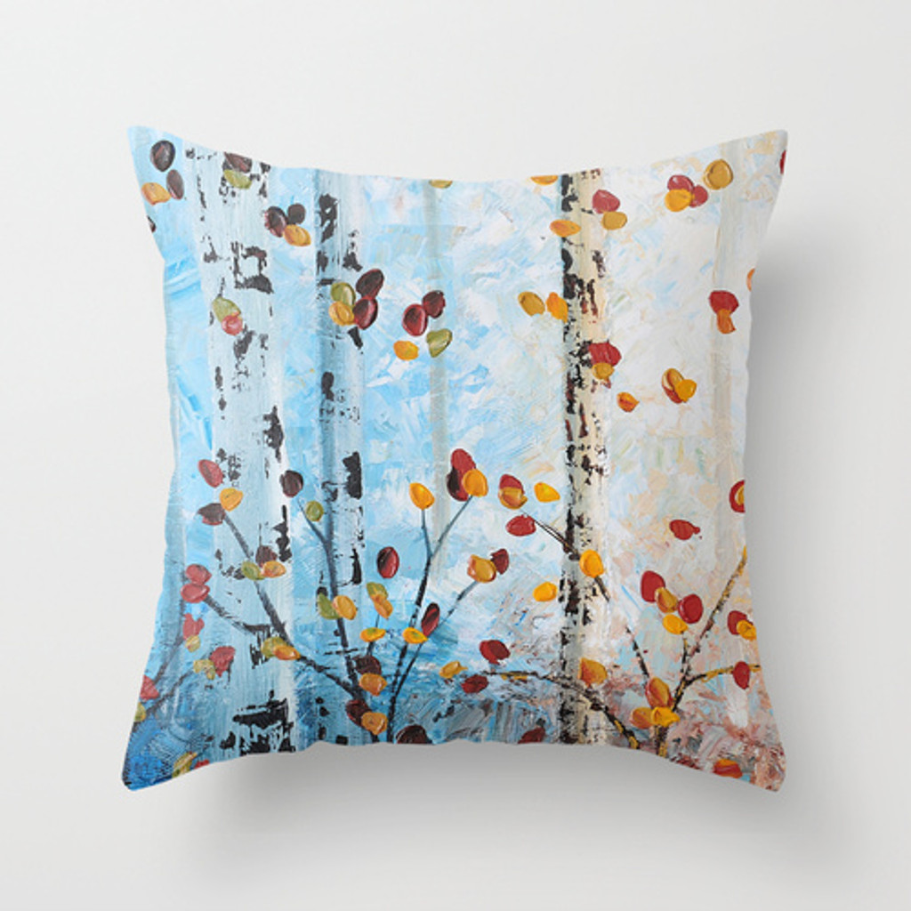 blue cushion printed with birch tree art