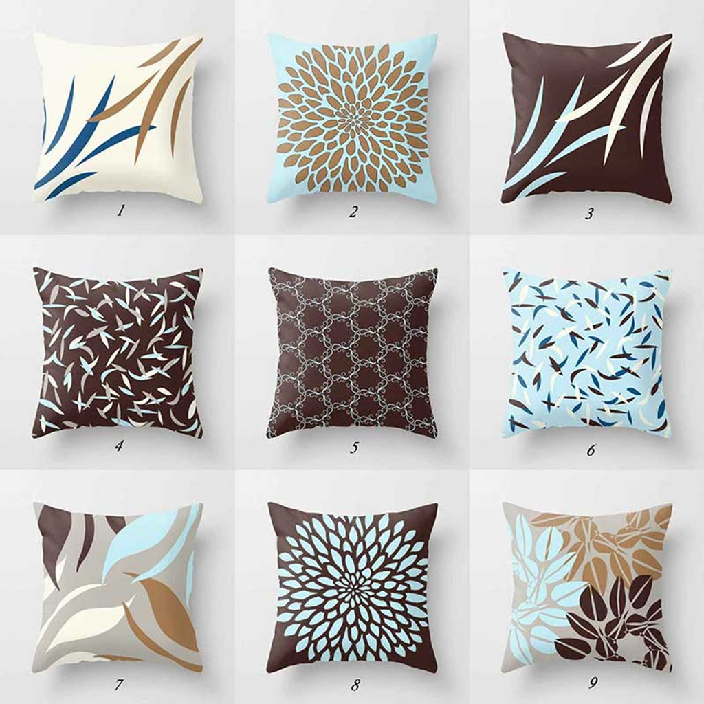 brown and blue cushions with floral and geometric design