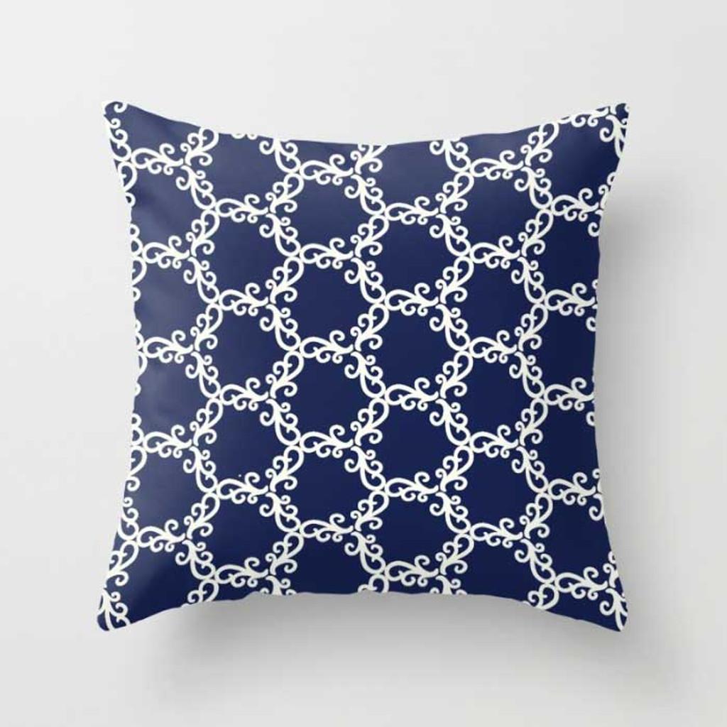 blue and white geometric throw pillow