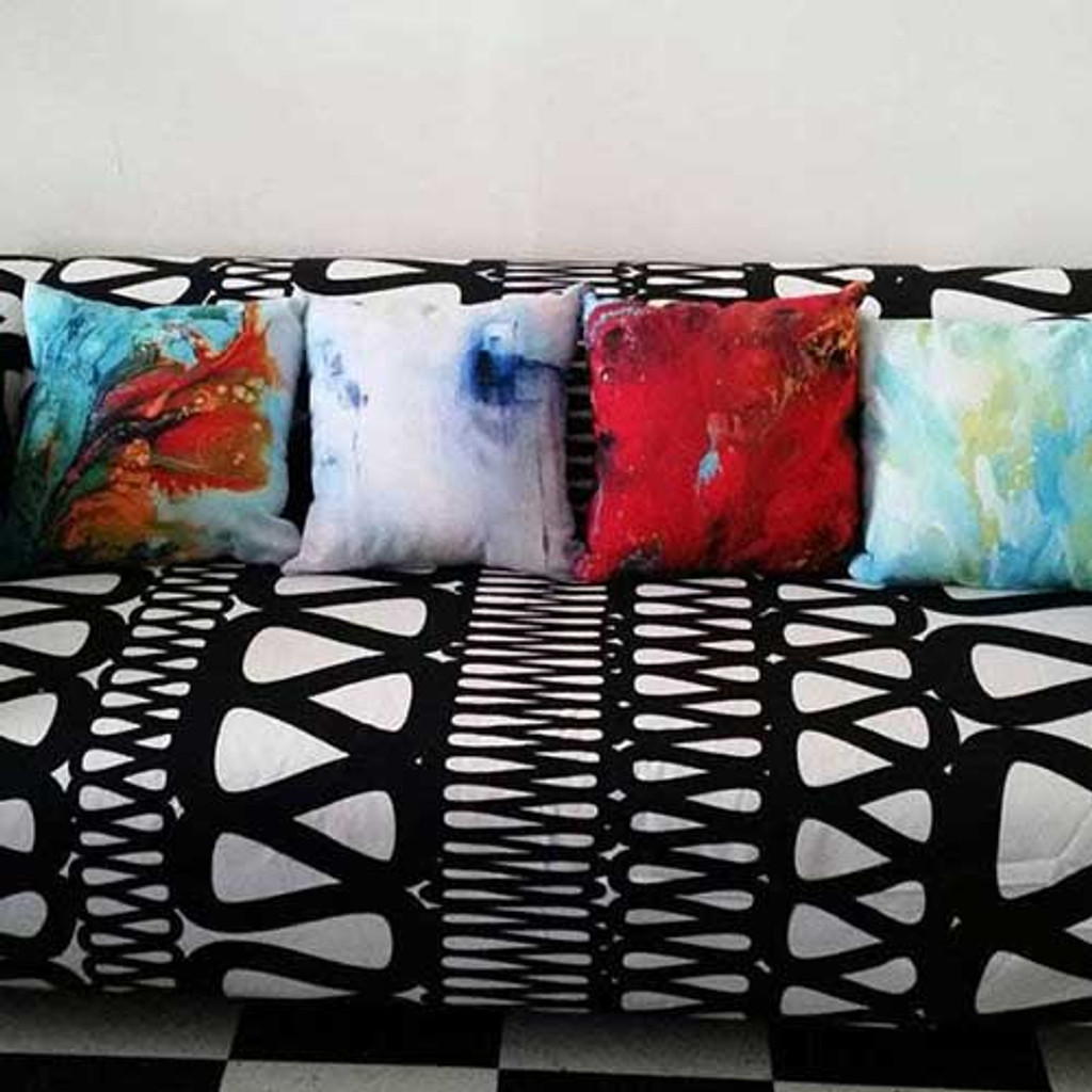 colorful abstract throw pillows on the couch