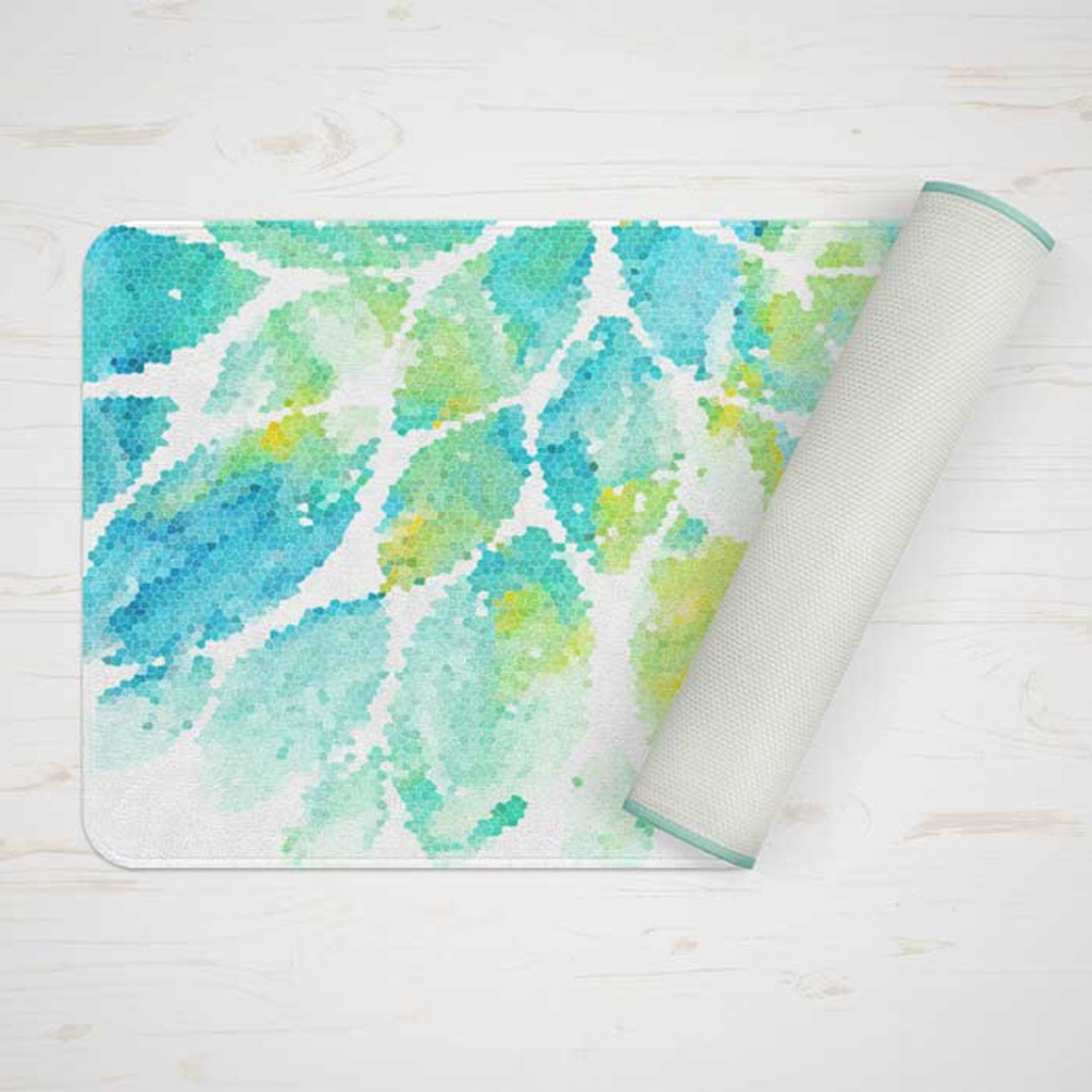 bath mat with floral design in mint green and blue