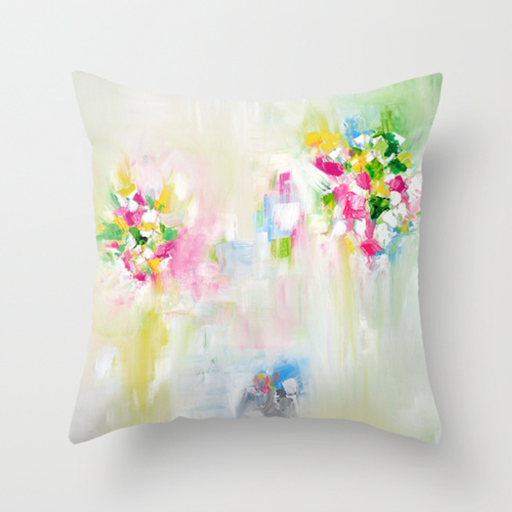 colorful art cushions in white, pink, green and yellow with abstract design