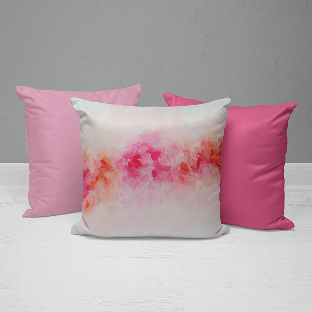 throw pillows in bright pink and light pink color