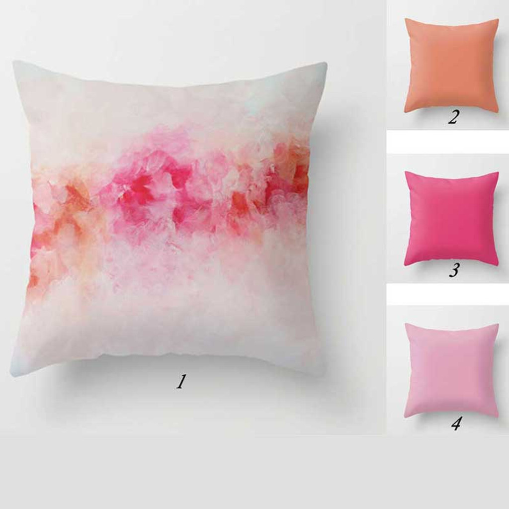 pink and coral throw pillows with abstract floral design