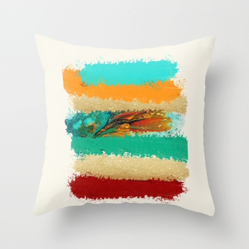 toss pillow with abstract design in red, orange and blue