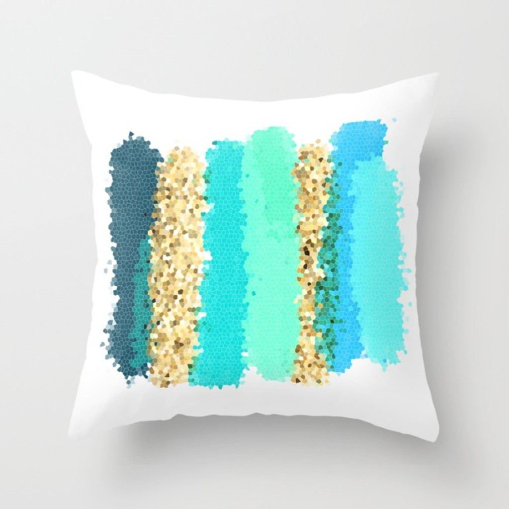 Toss pillow with art design in turquoise, teal and gold