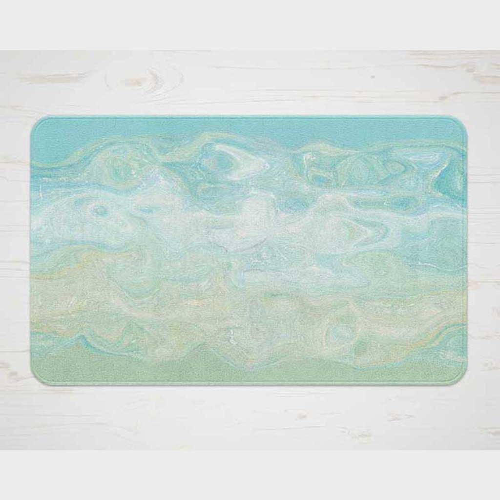blue and green plush bath mat with abstract design