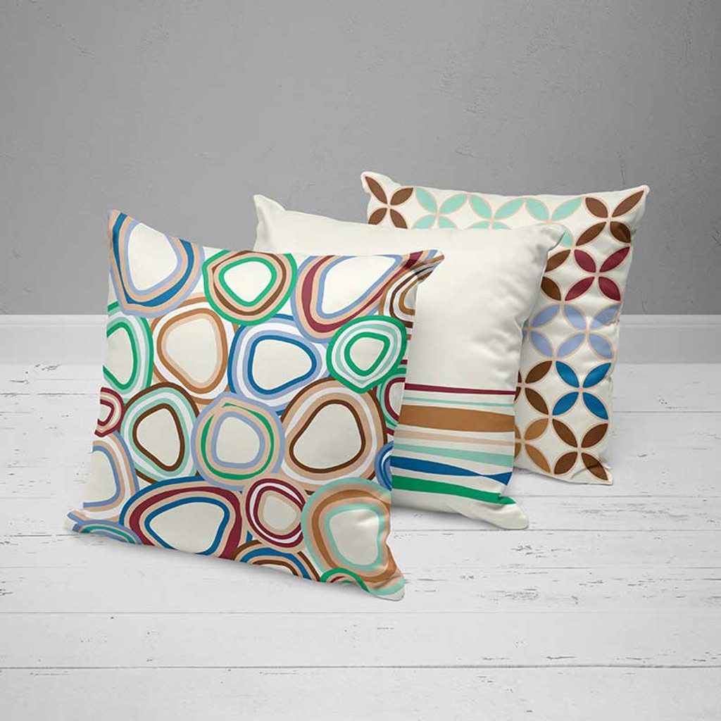 toss pillows with geometric design, blue, white, red