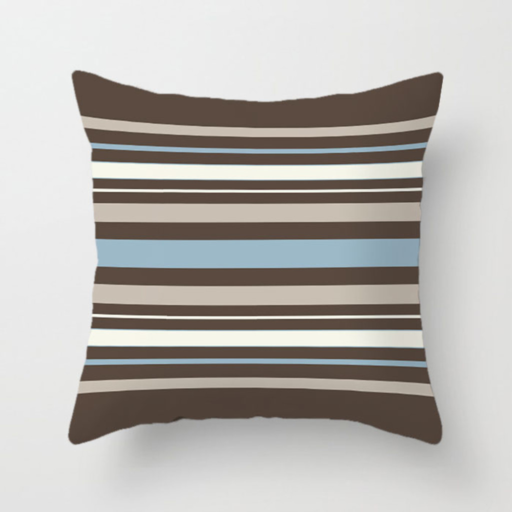 brown throw pillow with white and blue stripes