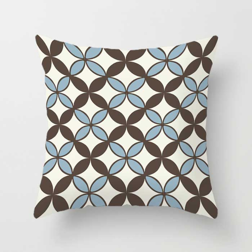 brown, white and blue cushion with geometric pattern