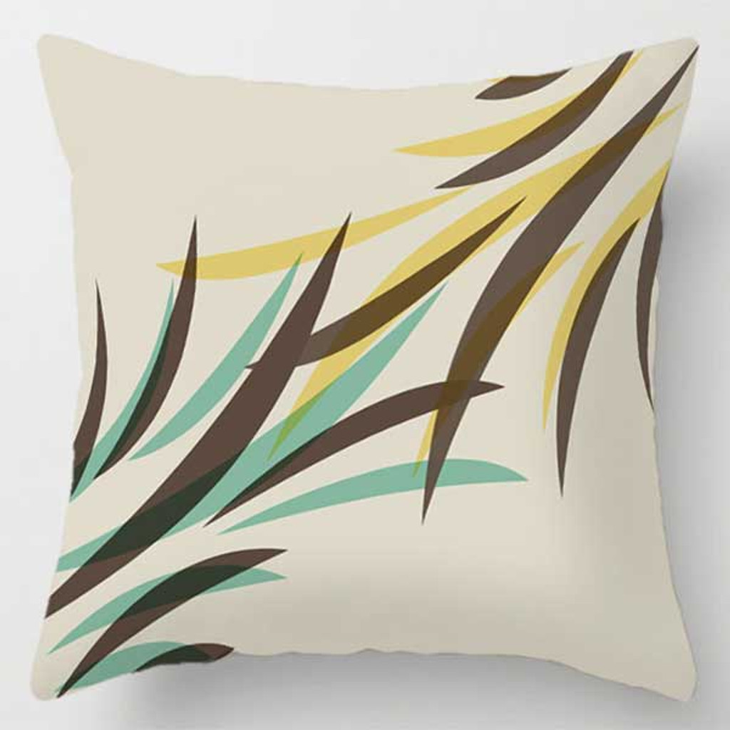 decorative cushion with brown, mint green and yellow leaf pattern