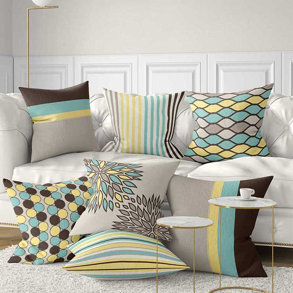 designer collection of decorative throw pillows in mint, yellow, blown and beige