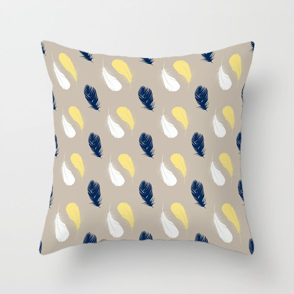 beige, blue and yellow pillow with feather pattern