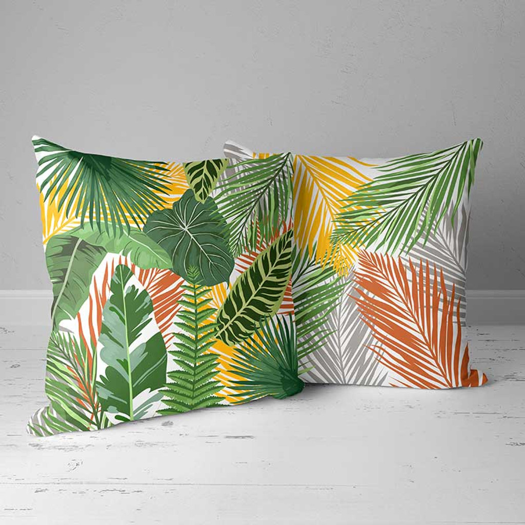 outdoor pillows with tropical theme in green and orange