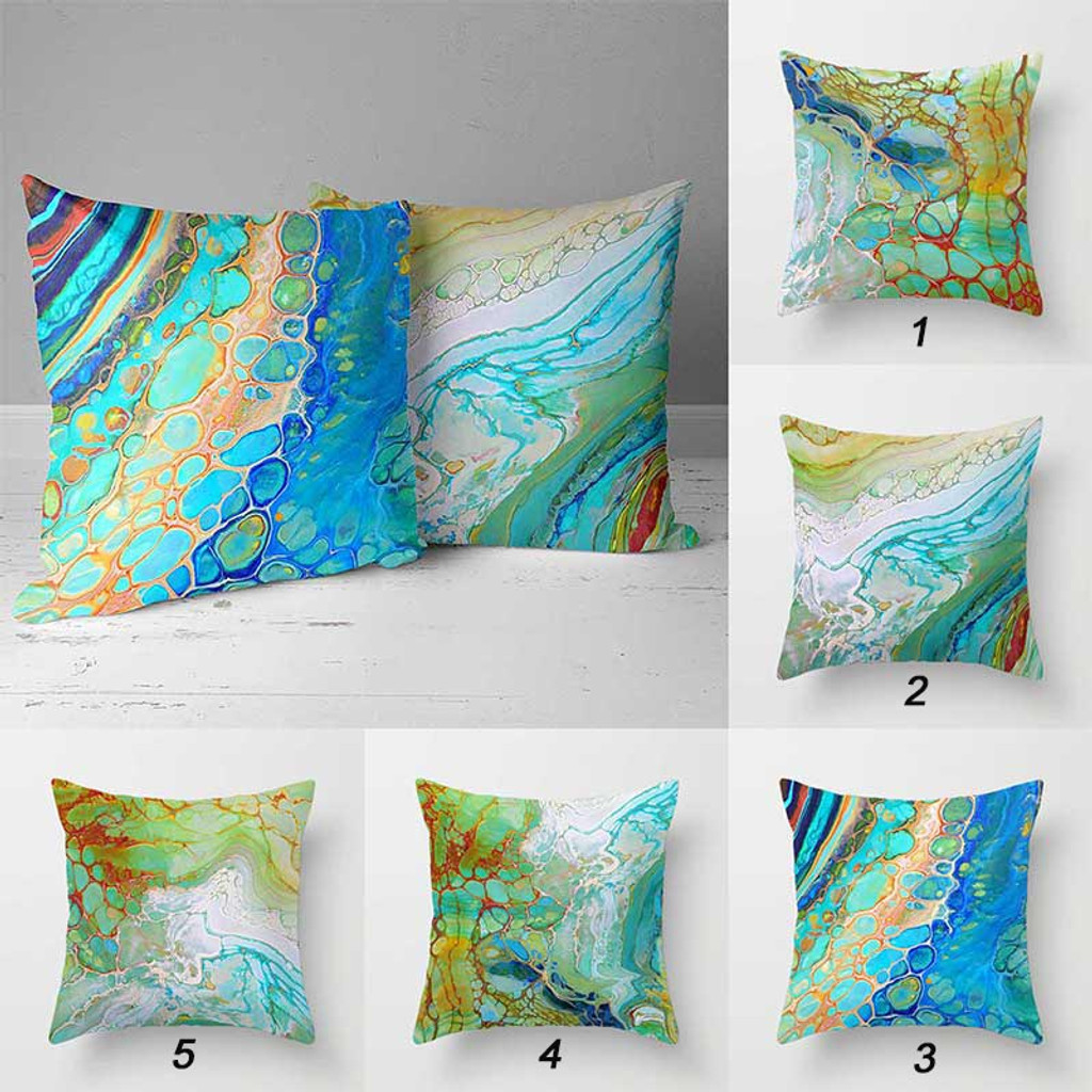 collection of patio pillows with coastal theme in aqua blue, green and orange