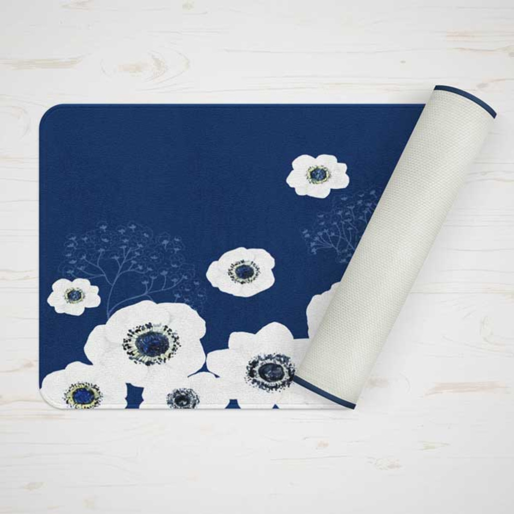 blue bath mat with large white flowers