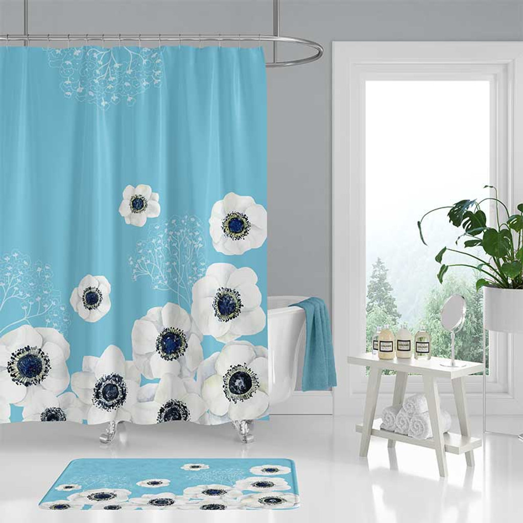 blue shower curtain with large white flowers