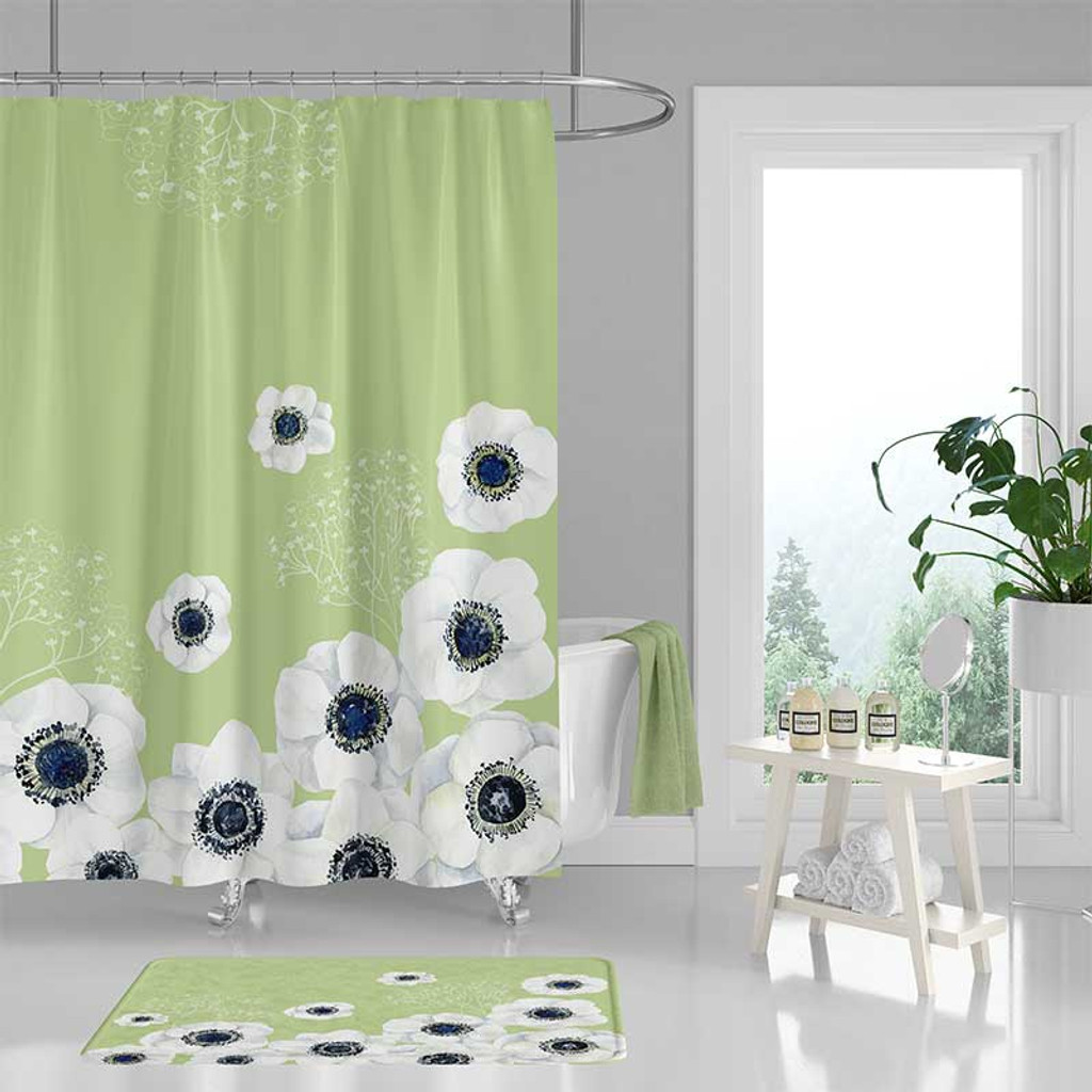 Mint green shower curtain with large white flowers