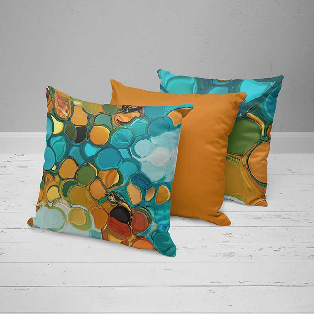 original cushions with artistic design in teal, blue and orange