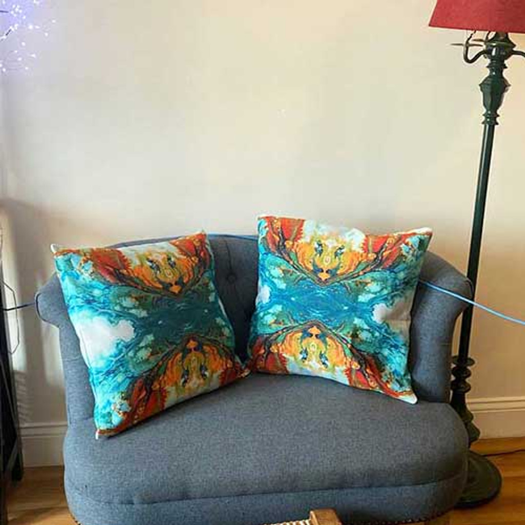 abstract art cushions in blue, teal and orange