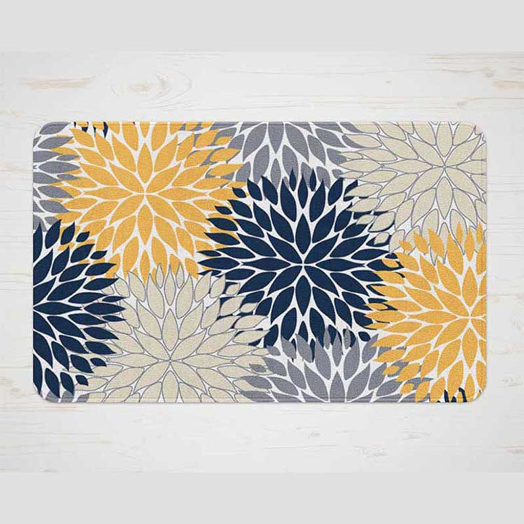 floral dahlia bath mat in yellow and navy blue