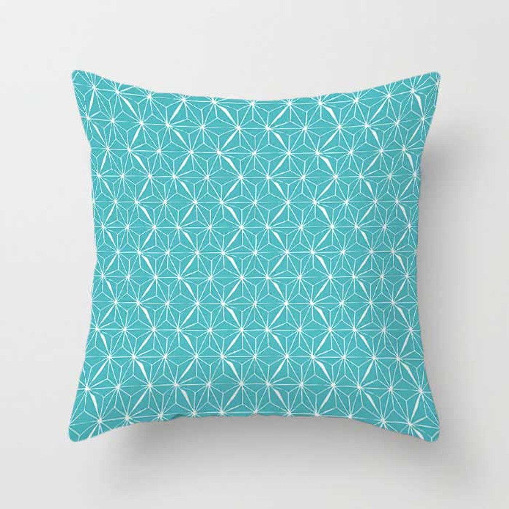 blue and white pillow with geometric pattern