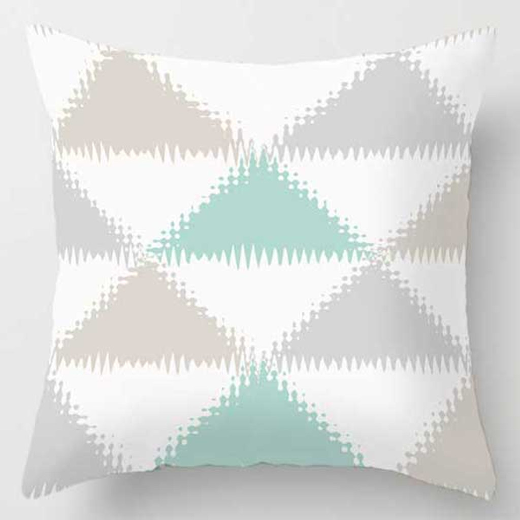 beige, gray and mint green pillow with geometric pattern