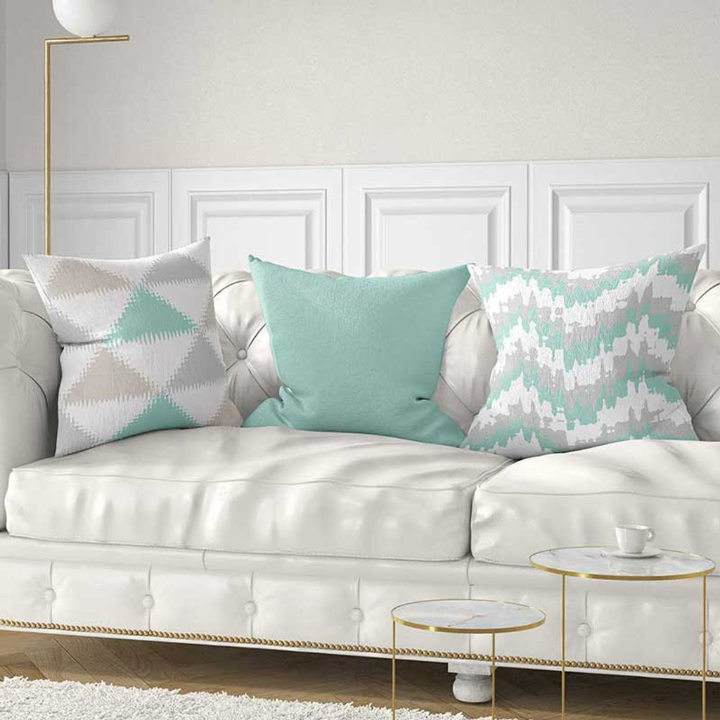 mint green and beige decorative pillows on the sofa