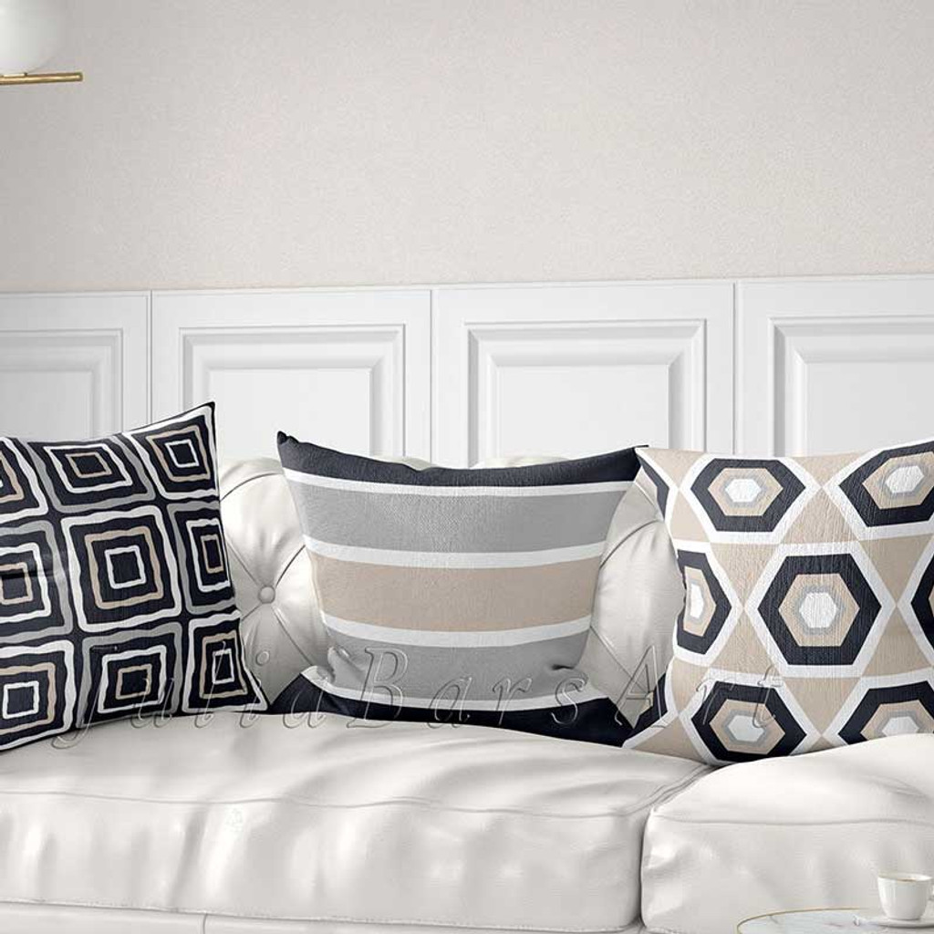 sofa pillows with stripes and geometric design in beige and gray