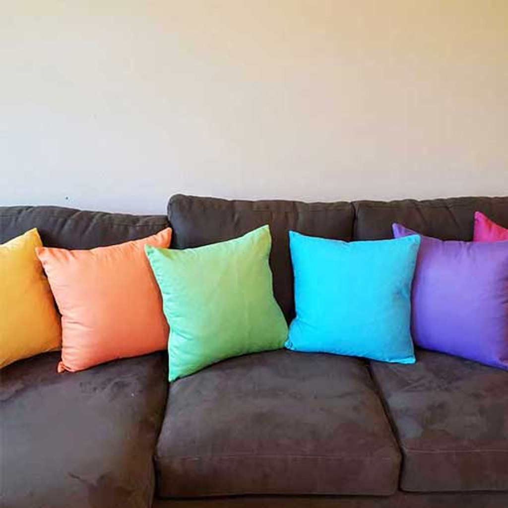 colorful green, teal, orange and purple throw pillows by Julia Bars