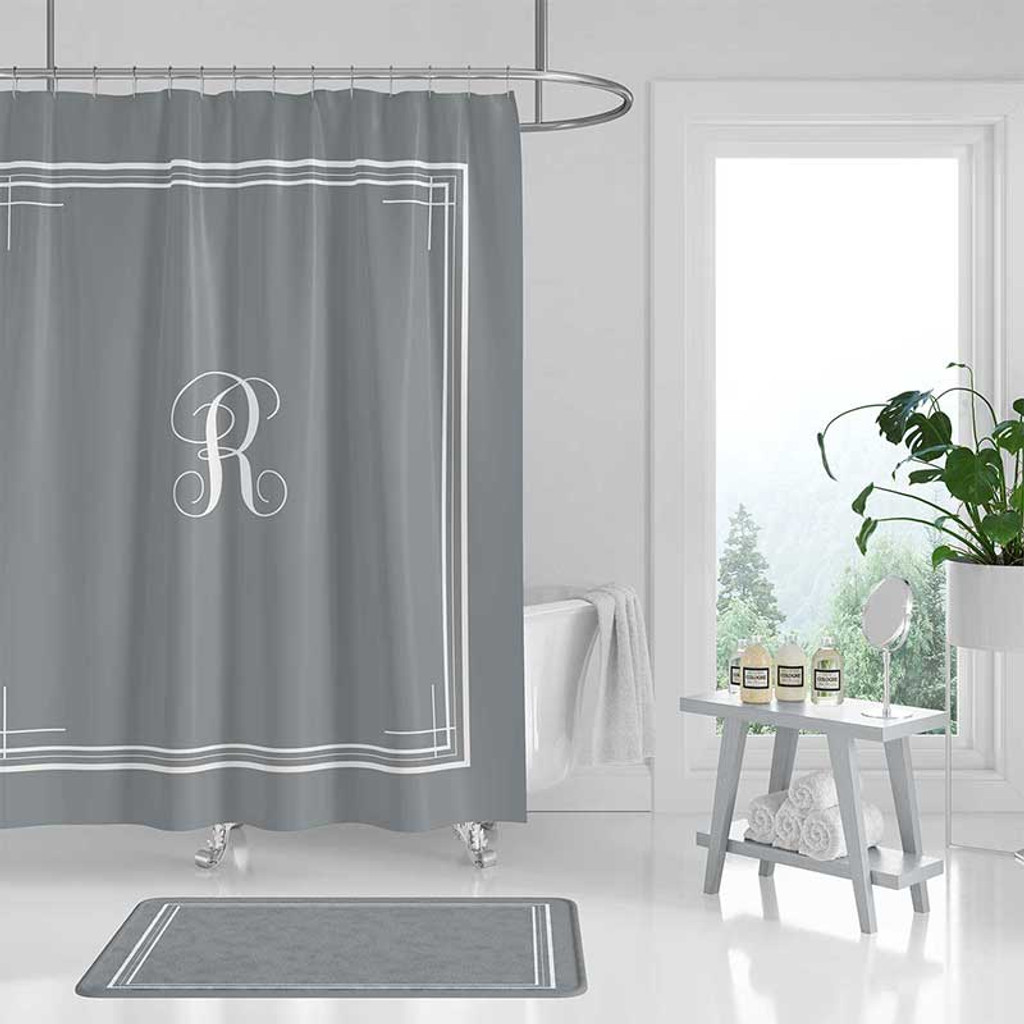 Gray shower curtain with white letter monogram and borders