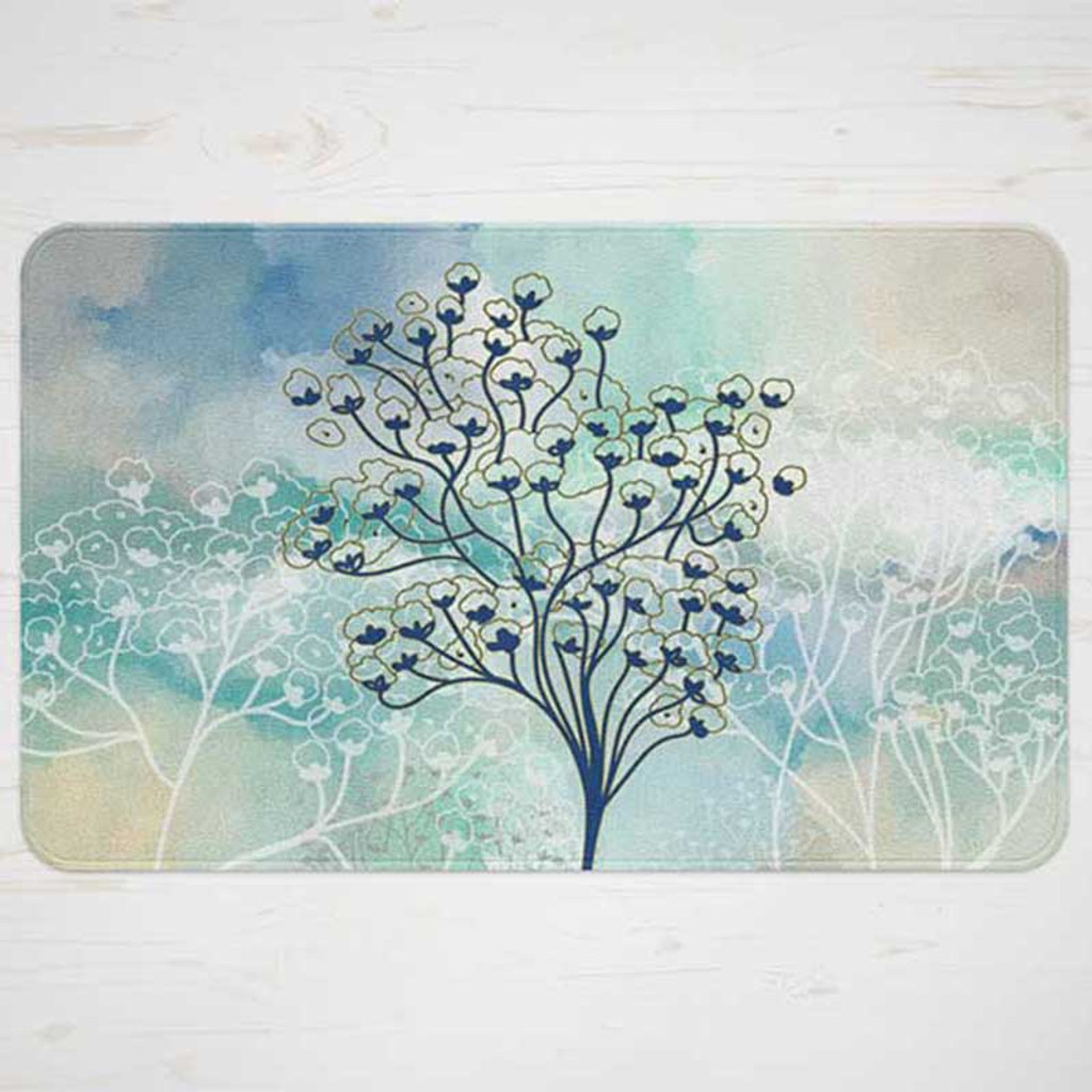 blue and beige bath mat with trees