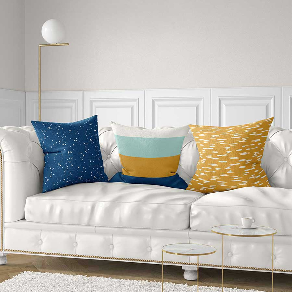 blue and yellow striped pillows