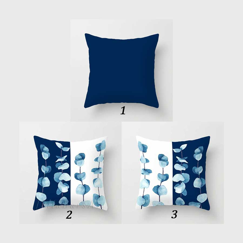 blue and white decorative pillows with floral pattern