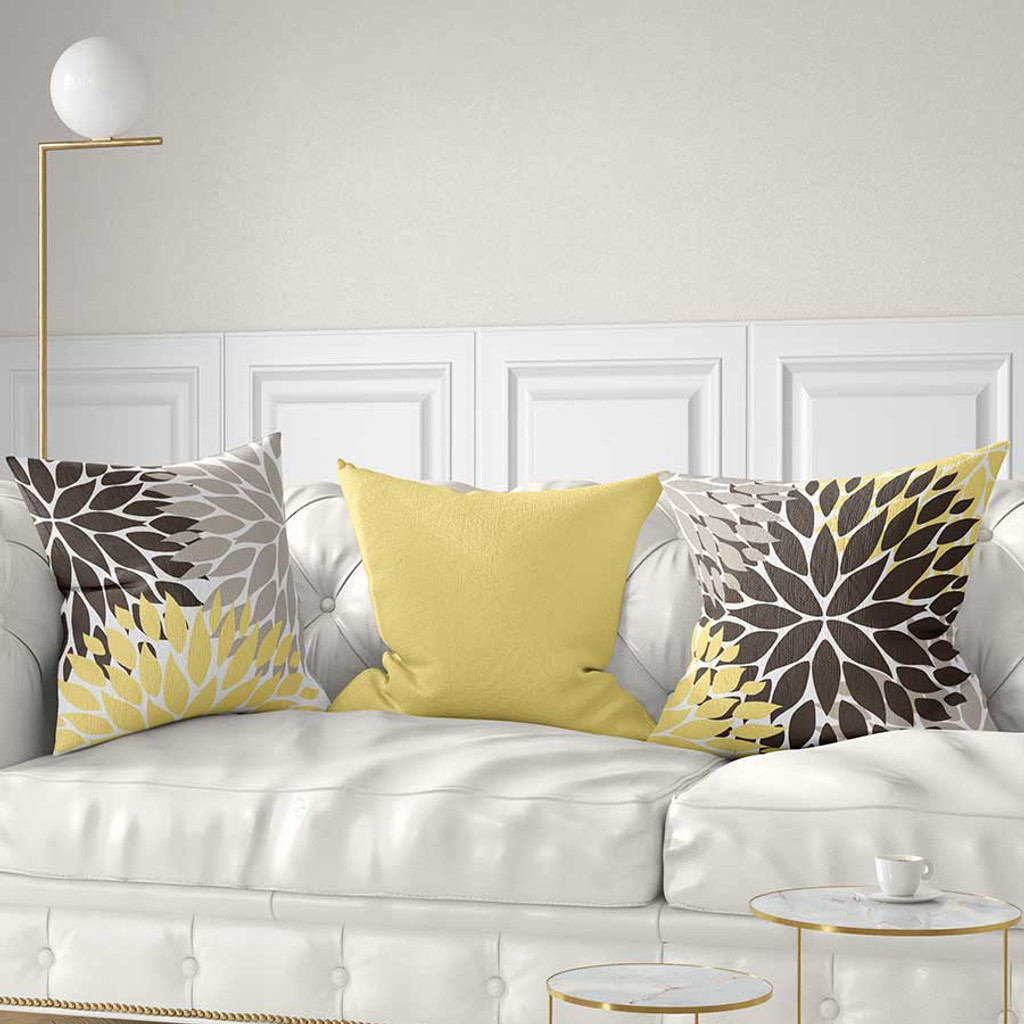 yellow, brown and gray floral throw pillows by Julia Bars